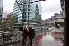People walking at London Wall, England, urban street scene with modern architecture Royalty Free Stock Image