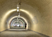 People walking in a long tunnel Royalty Free Stock Images