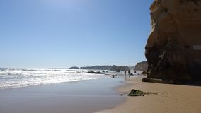 People walking on a lovely beach of Algarve in Portuga; Royalty Free Stock Photos