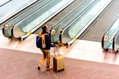 People walking with luggage in airport Stock Photos