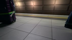 People walking with luggage in the underground. Low angle view of people walking with luggage in the underground stock footage