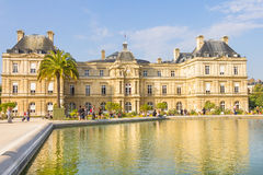 People walking in the Luxembourg Garden, Paris. Located in the Quartier Latin, the Palais du Luxembourg is part of the garden and the upper house of the French royalty free stock images