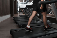 People walking machine treadmill at fitness gym club Royalty Free Stock Images