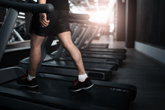 People walking in machine treadmill at fitness gym club Royalty Free Stock Images