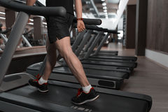 People walking in machine treadmill at fitness gym club Stock Photos