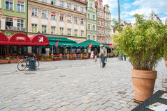 People walking on Main Market Square in Wroclaw. Royalty Free Stock Image