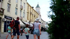 People walking on main street of Bitola. Bitola is the second biggest city of the Republi. BITOLA, MACEDONIA - JULY, 2015: People walking on main street of stock footage