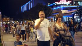 People walking on main street of Bitola. Bitola is the second biggest city of the Republi. BITOLA, MACEDONIA - JULY, 2015: People walking on main street of stock video footage