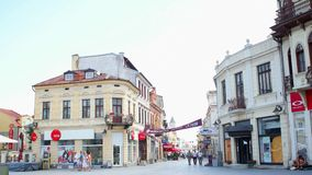 People walking on main street of Bitola. Bitola is the second biggest city of the Republi. BITOLA, MACEDONIA - JULY, 2015: People walking on main street of stock video
