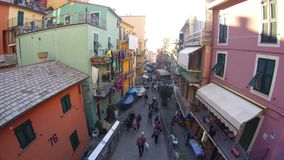 People walking in the main street or Vernazza, Italy stock footage
