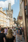 People walking on Mala Strana district - Prague. PRAGUE - AUGUST 5: People walking on the Mala Strana district, across St. Nicholas church  on august 5,2015 in Stock Images