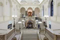 People walking on marble staircases at Vienna university Stock Photo