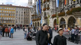 People walking in Marienplatz square on the the famous Town Hall. Munich, Germany stock video footage