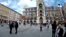 People walking in Marienplatz square on the the famous Town Hall. Munich, Germany stock footage