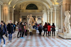 People walking through massive exhibits, The Louvre, Paris,France,2016 Royalty Free Stock Image