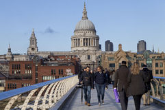 People walking on the Millennium Bridge in London Stock Image