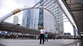 People walking on the modern bridge in business area on 27 March 2015 in Bangkok, Thailandound stock video