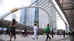 People walking on the modern bridge in business area on 27 March 2015 in Bangkok, Thailandound stock footage
