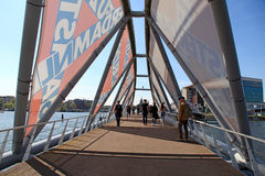 People walking on the modern bridge near the Nemo museum, Amster Royalty Free Stock Image