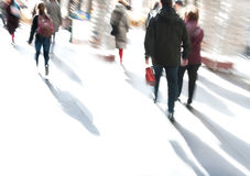 People walking in a modern interior, motion blur. Royalty Free Stock Photography