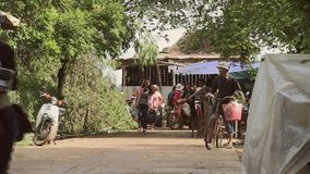 People, walking, motorbike , cambodia, asia Stock Photo