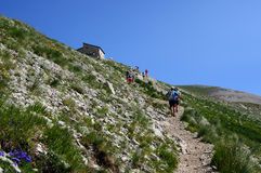 People walking on mountain Stock Photo