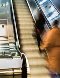 People walking on moving staircase in subway blur Stock Images