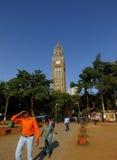 People walking in Mumbai India. Clock tower in Mumbai, India Royalty Free Stock Image