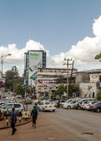 People walking in Nairobi. People walking through the capital of kenya, nairobi. It is an image on a sunny day. The picture was taken in May 2014. It´s a royalty free stock images