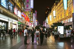 People walking on Nanjing Road at night in Shanghai. SHANGHAI, CHINA - MAY 18 : People walking on Nanjing Road at night on MAY 18, 2019 in Shanghai. Nanjing Road royalty free stock photo
