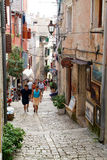 People walking in the narrow alley of Rovinj Stock Image