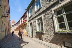 People walking on narrow street in old Tallinn Royalty Free Stock Photography