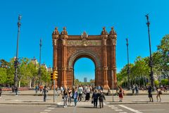People walking near  Arc de Triomf. BARCELONA, SPAIN - APRIL 9, 2017: People walking near  Arc de Triomf in Barcelona during a spring day Royalty Free Stock Photography