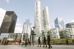 People Walking Near High Rise Buildings stock photography