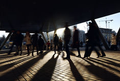 People walking near the metro station. City background with backlight sun Stock Images