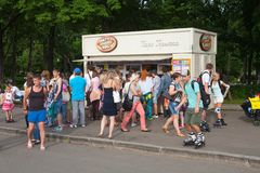 People walking near summer food store Royalty Free Stock Images
