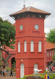 People are walking nearly the Clock tower in Malacca Stock Photo