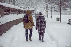 People walking on New York City Manhattan street during strong snow storm blizzard and cold weather Royalty Free Stock Photography
