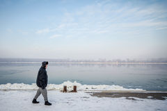 People walking next to the frozen Danube in Belgrade, Serbia, due to an exceptionally cold weather. A period of exceptionally cold and snowy winter weather in Royalty Free Stock Photos
