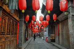 People walking in a nice decorated street in ancient town of Fenghuang Royalty Free Stock Photo