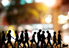 People walking in night Stock Photo