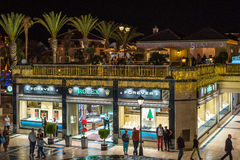 People walking at night street of Las Americas town on Tenerife island Royalty Free Stock Photo