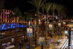 People walking at night street of Las Americas town on Tenerife island Royalty Free Stock Images