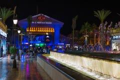 People walking at night street near Piramide de Arona resort. Royalty Free Stock Images