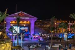 People walking at night street near Piramide de Arona resort. Royalty Free Stock Image