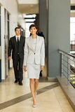 People walking office passage Stock Images