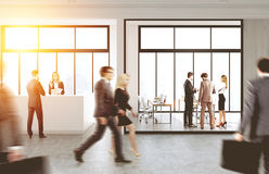 People walking in office with reception. People are walking in an office with a reception counter and glass walls. 3d rendering, toned image Royalty Free Stock Photos