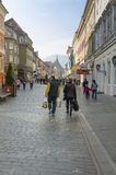 People walking in the Old Town of Brasov stock photography