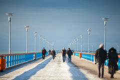 Free People Walking On The Pier Stock Photos - 57175833