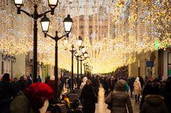 People are walking on one of the festively decorated streets in Moscow stock photo